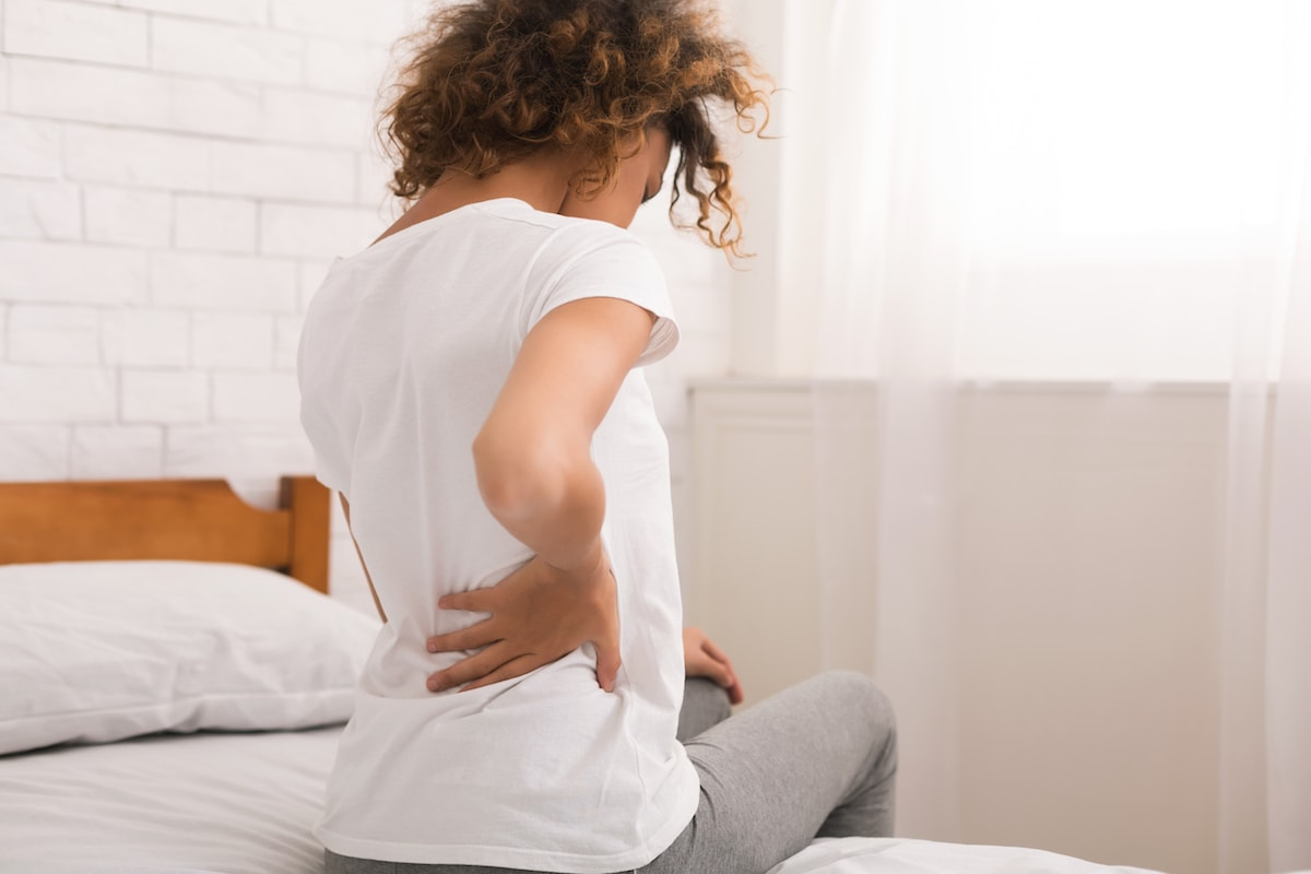 African American Woman Having Back Pain - SolVibrations