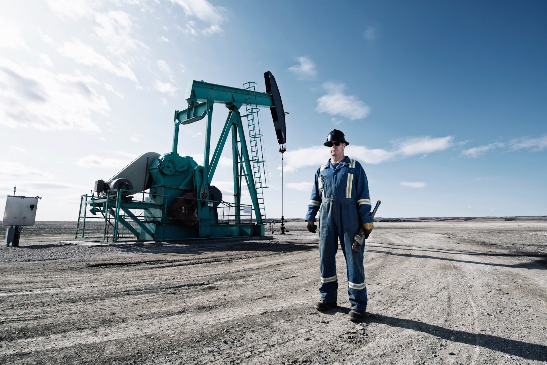Oil Industry Worker With Safety Equipment - SolVibrations