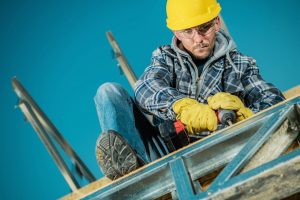 Construction Worker Using Hand Drill - SolVibrations