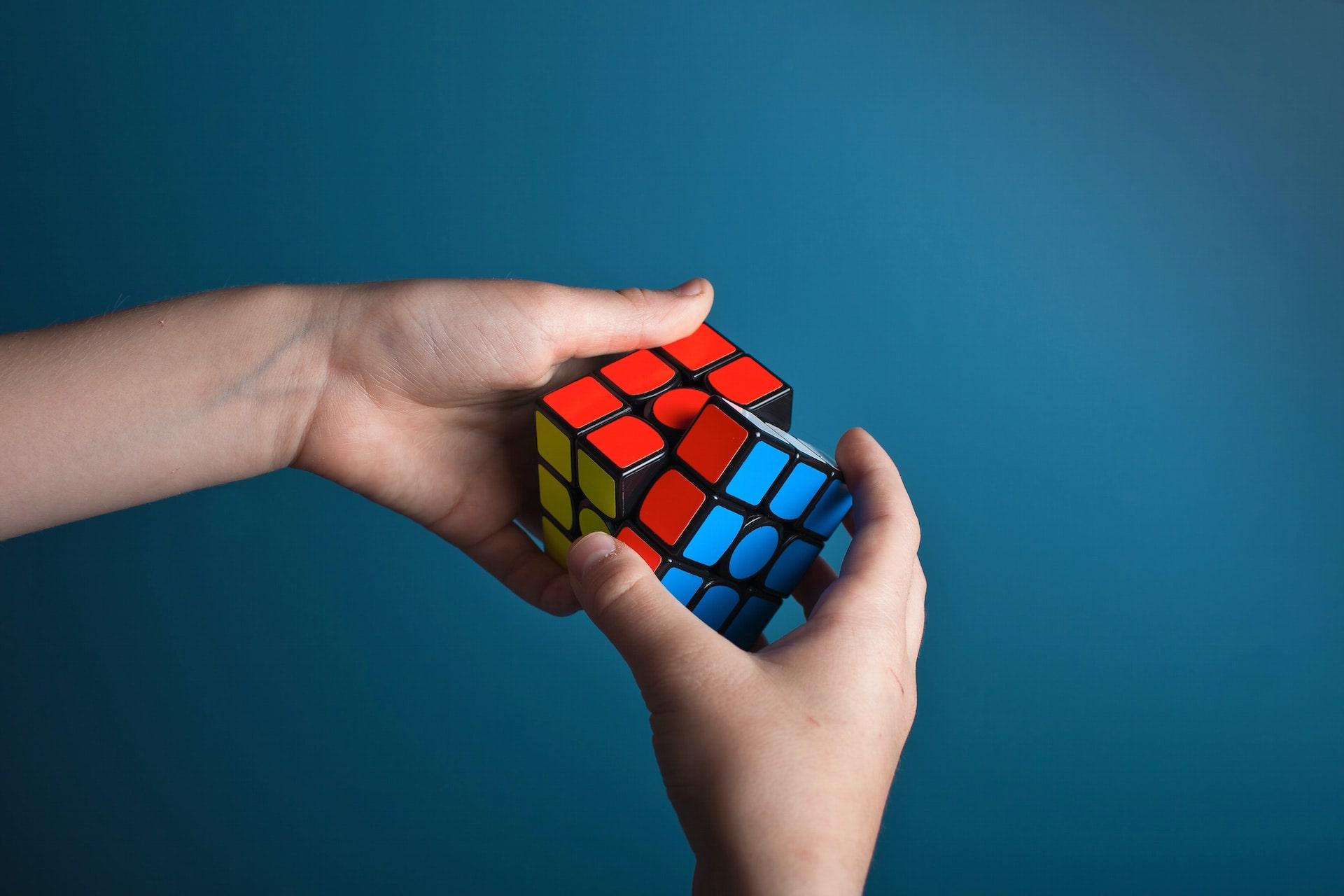 Female Hands Resolving a Rubik's Cube - SolVibrations