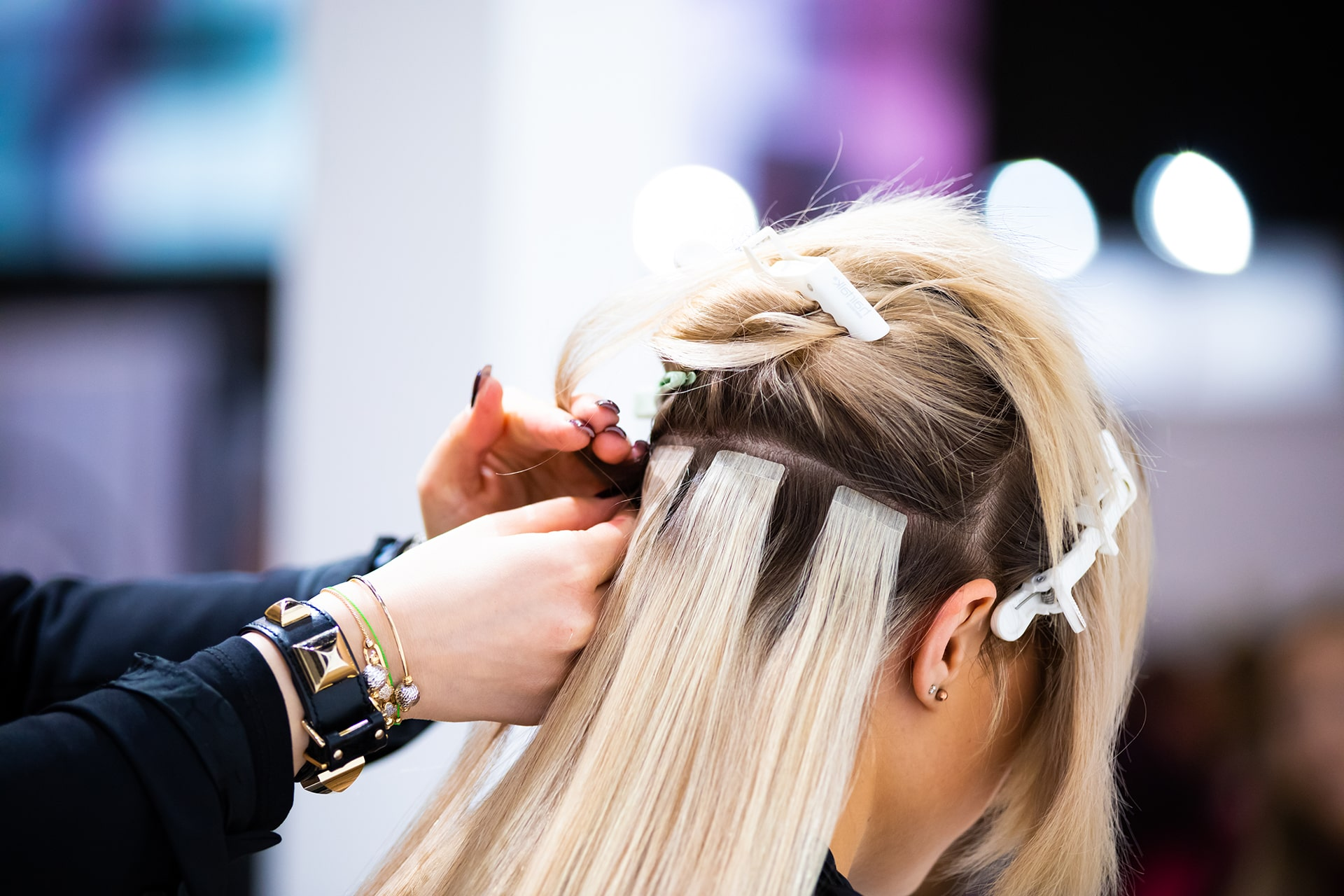 Professional Hairdresser Making Hair Extensions SolVibrations